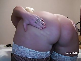 Blonde squirts down her legs