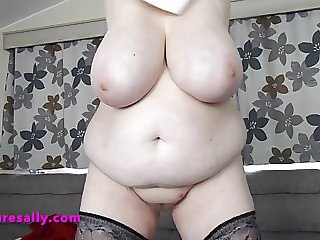 Sally removes her skirt and panties