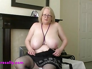 Sally flashes her mature curves at home