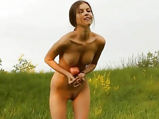 Cute ponytailed girl posing outdoors