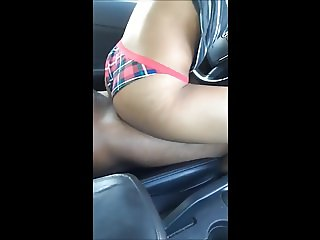 Black slut bouncing on his cock in the car after class