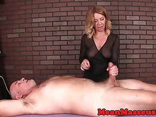 Mature masseuse dominating with toy during hj