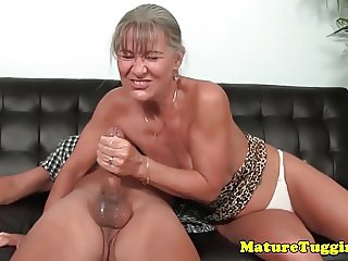 Naughty cougar tugging cock till cum
