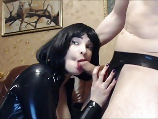 Slut In Black Latex and Thigh Boots Sucks for Facial Cumshot