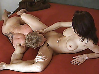 Slutty and busty amateur Milf in action on her bed