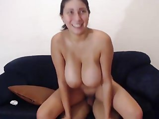 Busty babe riding a dick