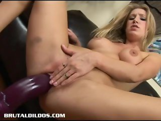 Amazing blonde Allison Pierce bouncing on a giant dildo