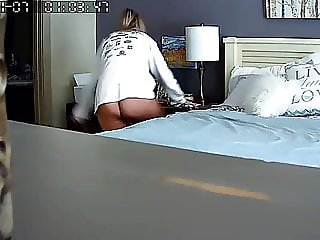 Caught mom on her bed with a vibrator in her bedroom.