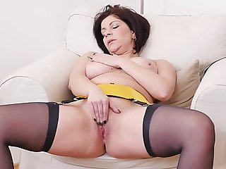 Euro milf Nicol does a slow striptease and plays