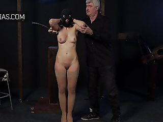 Big titty girl must not move while she is caned