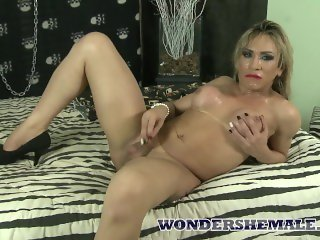 Blonde latina shemale Tuanny explores her cock solo