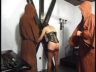 Two monks show her in a horny rite what happens when she is