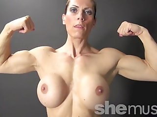 Naked Female Bodybuilder Shows Off Big Biceps and Boobs