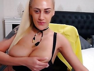Nikky teases with her huge boobs on cam