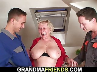 Busty blonde granny gets double fucked