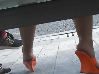 Candid orange mules and pantyhose