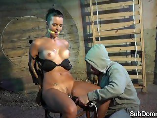 Lingerie sub toyed while bound to a chair