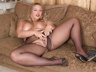 Curvy blonde wanks dildo toy in shimmering nylon pantyhose