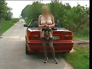 Gisela secretary outside with suspenders and vibrator