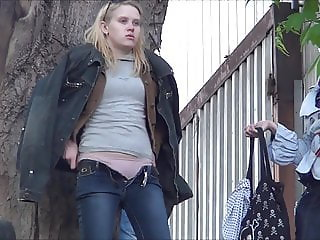 Two shaved blondes take a piss outdoors