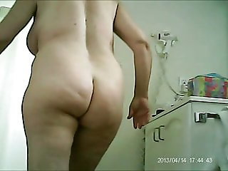 Slut step-mom getting ready to go out to find cock