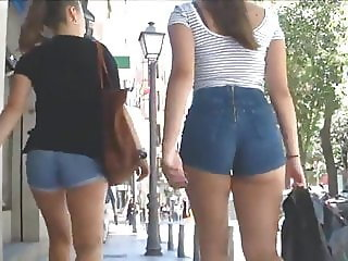 Beautiful asses of shorts parading on the street of Spain