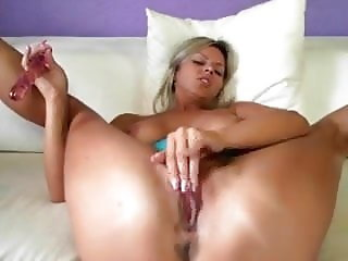 Blonde bitch toying her pussy