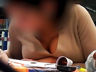 Busty young woman studying (part 2)