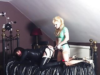 Latex Slutty Guy pegged by blonde latex nurse!