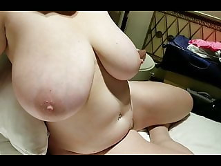side bobs view of Lateshay 38HH natural tits