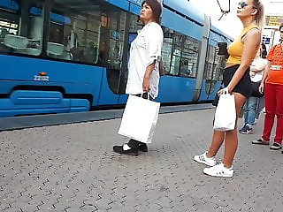 Girl wait for tram 6