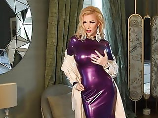 Blonde Latex Girl wears long elegant dress