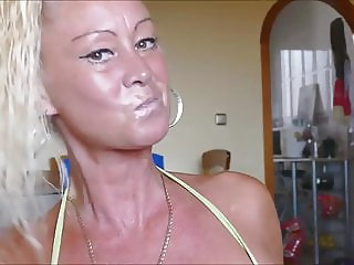 tanned milf sucking cock