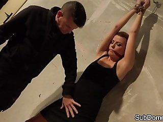 Restrained beauty orgasms while groped
