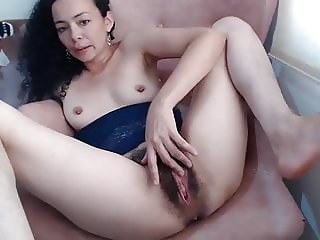 Mature babe playing with her big hairy pussy