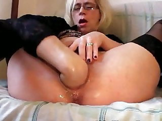 Slutty Grandma In Stockings Fisting Pussy by Dracarys69