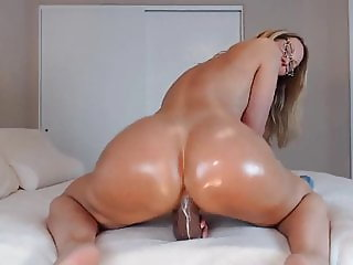Older women with a big ass ride a huge black dildo