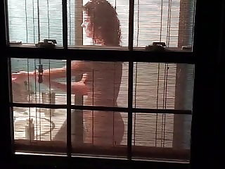 Voyeur spies sexy neighbor girl through window