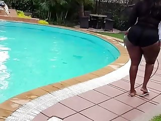 Kenyan big bum walking in a swim suit