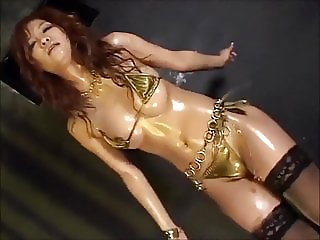 Oiled Japanese micro bikini dancers