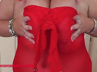 Big Bosoms in a red dress