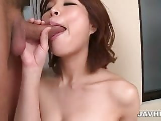 Busty Erika Nishino goes nasty on two strong cocks