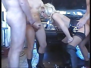 Hot Blonde German MILF Takes on 3 Dudes in a Garage