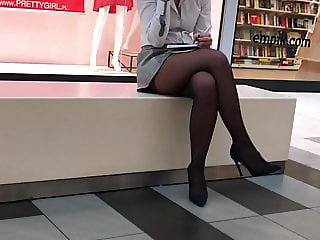 Girl in sexy black stocking at work