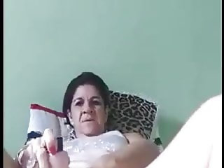 Brazilian mature playing with her dildo
