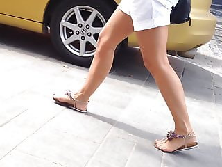 candid girl tan legs, feet, white shorts, sandals,walking