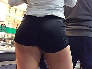 Volleyball player's deliciously round ass in line