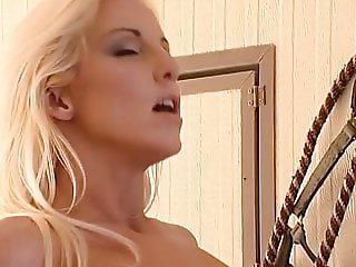 Gorgeous blonde gets fucked in the barn by the farmer boy