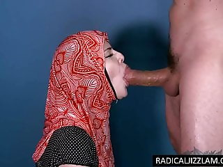 Infidel girl with hijab sucks a big white cock for cum