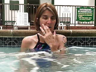Skinny wife flashing her hairy pussy in the hotel pool